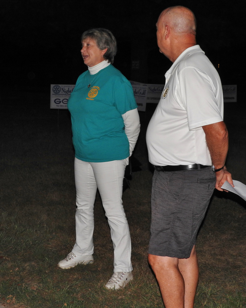 President Selina welcomes golfers while Chairman John shows off his trim physique
