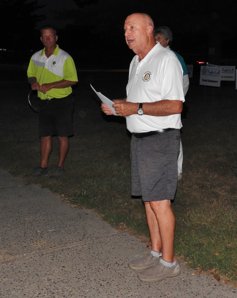 Golf Committee Chair John Baer trying to read his notes in the dark...where's the teleprompter?